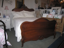 French rolled top bedstead At Staveley Antiques