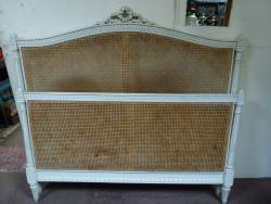 French cane kingsize bedstead At Staveley Antiques